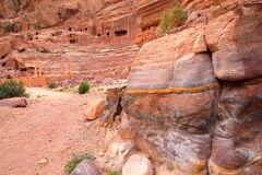 PETRA, JORDAN: Colorful sandstone with the Theater in the background Stock Photography