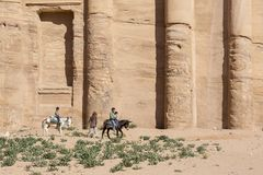 PETRA - JORDAN  December 25th 2015: Arab boys riding donkeys Stock Photo