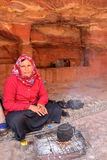PETRA, JORDAN, MARCH 12, 2016: Portrait of a bedouin woman preparing tea Stock Photos