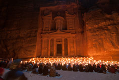 Petra, Jordan at Night. Al Khazneh in Petra, Jordan. Al Khazneh was carved out of a sandstone rock face. It has classical Greek-influenced architecture. It is Royalty Free Stock Photo