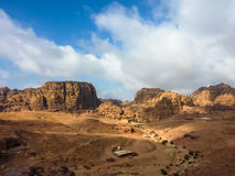 PETRA, JORDAN, NOV 25, 2011: Panoramic view of a red rose rock for. Mation against a blue sky in Petra Rose City, Jordan. Petra is one of the New Seven Wonders Stock Images