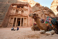 Petra in Jordan. PETRA, JORDAN - OCTOBER 12: Camel in front of the treasury or Al Khazna, it is the most magnificant and famous facade in Petra Jordan, it is 40 Royalty Free Stock Image