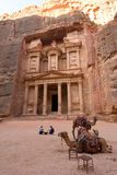 Petra in Jordan. PETRA, JORDAN - OCTOBER 12: Camels in front of the treasury or Al Khazna, it is the most magnificant and famous facade in Petra Jordan, it is 40 Stock Photo