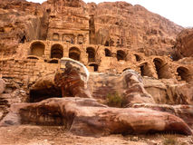 PETRA, JORDAN: Rock Temple and residential buildings of city in Petra Rose City. PETRA, JORDAN: In the foreground there are multicolored, pink-red rock Stock Images