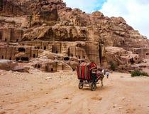 PETRA, JORDAN: Tourist transport carriage in Petra. Petra, Jordan. PETRA, JORDAN: In the foreground there is a tourist transport, in the background there are Royalty Free Stock Photos