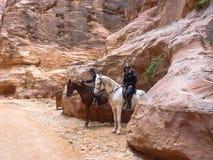 PETRA, JORDAN: Two policemen on horseback, Petra. PETRA, JORDAN: Two policemen on horseback against the backdrop of rosy red rock, Petra Rose City Royalty Free Stock Images