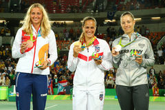 Petra Kvitova CZE L, Monica Puig PUR and Angelique Kerber GER during medal ceremony after tennis women`s singles final Stock Image