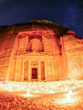 Petra by night. Night show at Petra. Long exposure fisheye image showing Al Khazneh by candlelight and starry sky Stock Photos