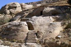 Fragment of a rock with a stone staircase in Jordan. Petra, originally known as Raqmu, is a historical and archaeological city in southern Jordan. It was Royalty Free Stock Images