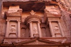 Fragment of an ancient temple carved into the rock of a rose stone. Petra or Raqmu, is a archaeological city in Jordan. It was  the capital city of the Nabataean Stock Photos