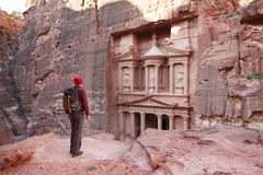 Petra. Traveler looking at the Treasury. Petra, Jordan. Toned Image Stock Image