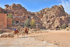 Petracamel. Tombs and carved structures in Petra, Jordan. Note Camel shaped mountain tops Stock Images