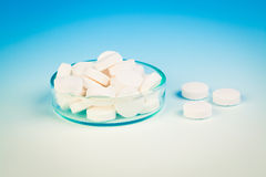 Petri dishes,  medicine tablet antibiotic pills. Stock Photo