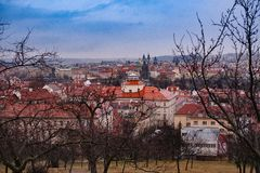 Petrin gardens and houses in the historical center of Prague. Overcast weather stock photo