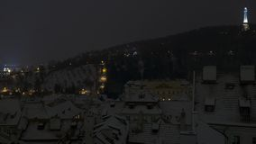 Petrin hill winter night view from afar. Petrin hill and snowy roofs in winter night view from afar Stock Photography