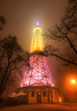Petrin Tower in Prague at Night in Fog Stock Photo