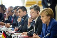 Petro Poroshenko, Angela Merkel and Pavlo Klimkin. Meeting in Paris Stock Photo