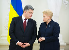 Petro Poroshenko and Dalia Grybauskaite. VILNIUS, LITHUANIA - Dec 02, 2015: President of Ukraine Petro Poroshenko and President of Lithuania Dalia Grybauskaite Royalty Free Stock Photography