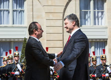 Petro Poroshenko and Francois Hollande Stock Images