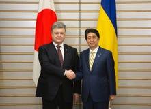 Petro Poroshenko and Shinzo Abe Stock Images