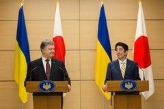 Petro Poroshenko and Shinzo Abe Stock Photo