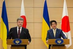 Petro Poroshenko and Shinzo Abe Stock Photos