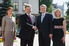 Petro Poroshenko and Stephen Harper with wives Stock Images