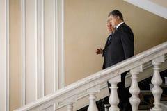 Petro Poroshenko y Rex Tillerson Fotografía de archivo