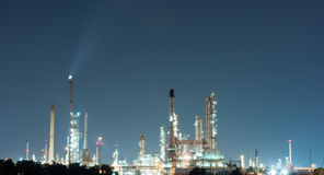 Petrochemical industrial plant power station. At dark of Thailand Stock Photos