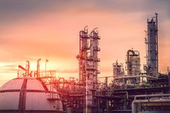 Petrochemicals plants. Petrochemical industrial on sky sunset background, Factory with evening time, Gas sphere tank and storage tank in oil refinery plant on Stock Photography