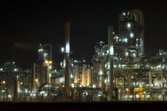 Petrochemical industry. Showing stainless steel tubes and pipes at night Stock Images