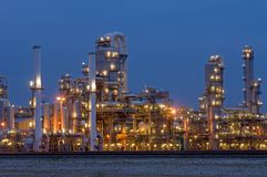 Petrochemical Industry. A petrochemical plant, with it's stainless steel cylinders, it's valves, chimneys, pipes, tubes and construction artificially lit just Royalty Free Stock Photos