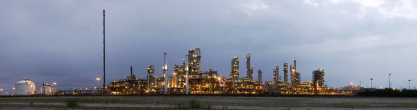 Petrochemical industry at dawn. A 22 stitched image panoramic of a petrochemical plant at a Grey, gloomy dawn Stock Photo