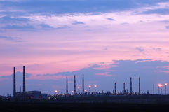Petrochemical industry view. Petrochemical industry night view over cloudy sunset Stock Photos