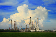 Petrochemical oil refinery with cloud and blue sky. Royalty Free Stock Images