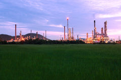 Petrochemical oil refinery plan with green field Stock Photography