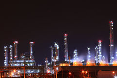 Petrochemical oil refinery plant shines at night, Stock Photos