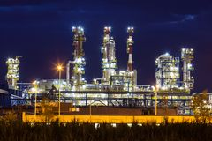 Petrochemical oil refinery plant shines. At night Royalty Free Stock Images