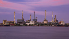 Petrochemical oil refinery plant at sunset Royalty Free Stock Image