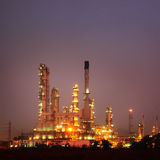 Petrochemical oil refinery plant at twilight. Royalty Free Stock Images