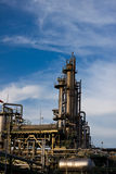 Petrochemical plant. Tower and piping in factory Stock Photos