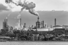 Oil and gas industry refinery near lake black and white. Petrochemical plant in city of Los Angeles near Lake Machado. Black and white Royalty Free Stock Photo