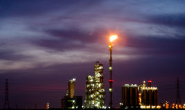 Petrochemical plant and flare at twilight Royalty Free Stock Image