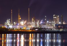 Petrochemical plant in night. Night scene of petrochemical plant with water reflection Royalty Free Stock Images