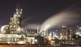 Petrochemical plant at night - Oil refinery Royalty Free Stock Image