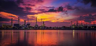 Petrochemical plant. In night time with reflection over the river Stock Photo