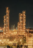 Petrochemical plant. Or oil and gas refinery industry and lighting at night time Stock Photos