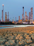 Petrochemical plant at sunset time. Enviromental effect with Petrochemical Plant Stock Images