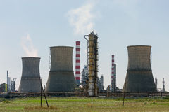 Petrochemical plant. Tubes and cooling towers on a petrochemical industrial plant Stock Images