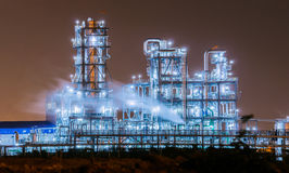 Petrochemical plant at twilight. Petrochemical plant in the night Royalty Free Stock Image